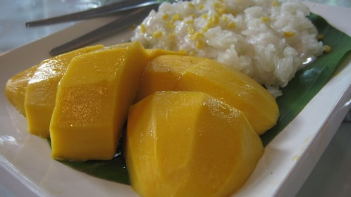 mango and rice on plate
