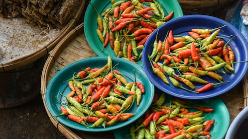bowls of bright colored chilis