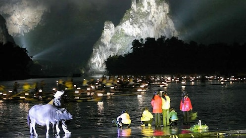 performing at night with natural backdrop in Guilin
