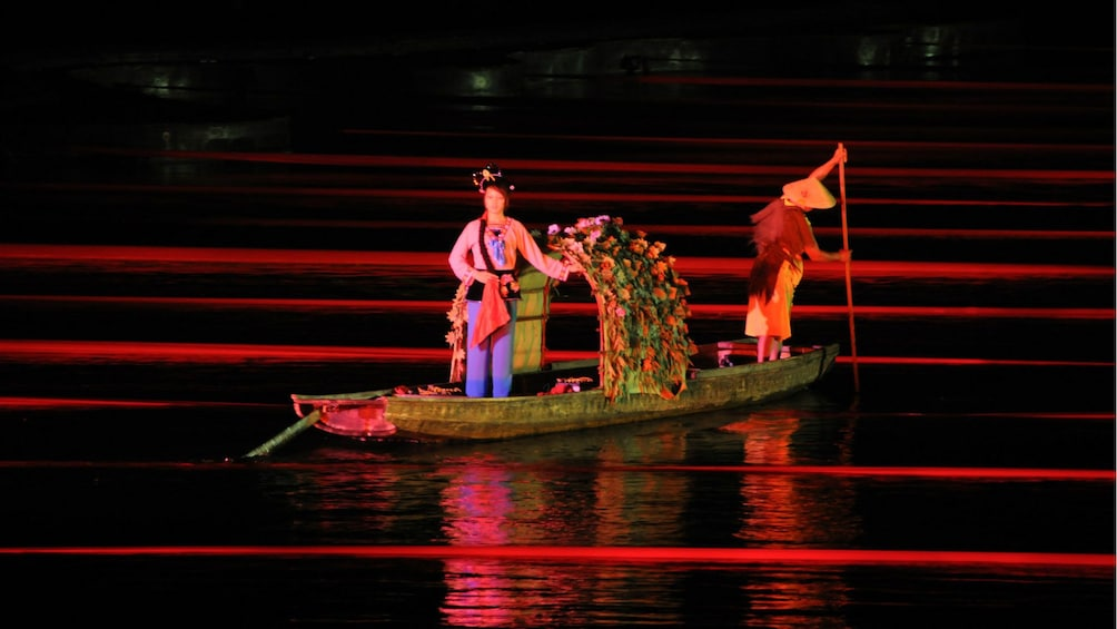 Show item 2 of 5. performers on a boat at night in Guilin