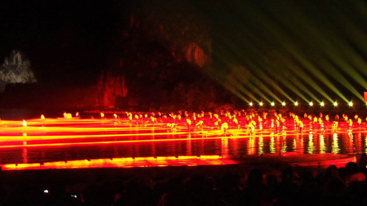 performers immersed in dazzling light show in Guilin
