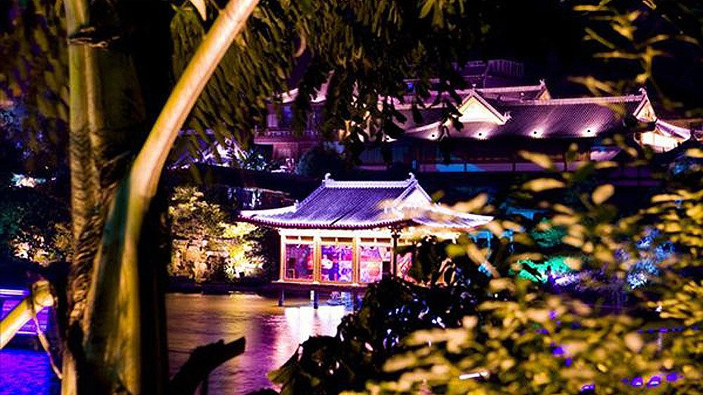 illuminated temple along the river in Guilin
