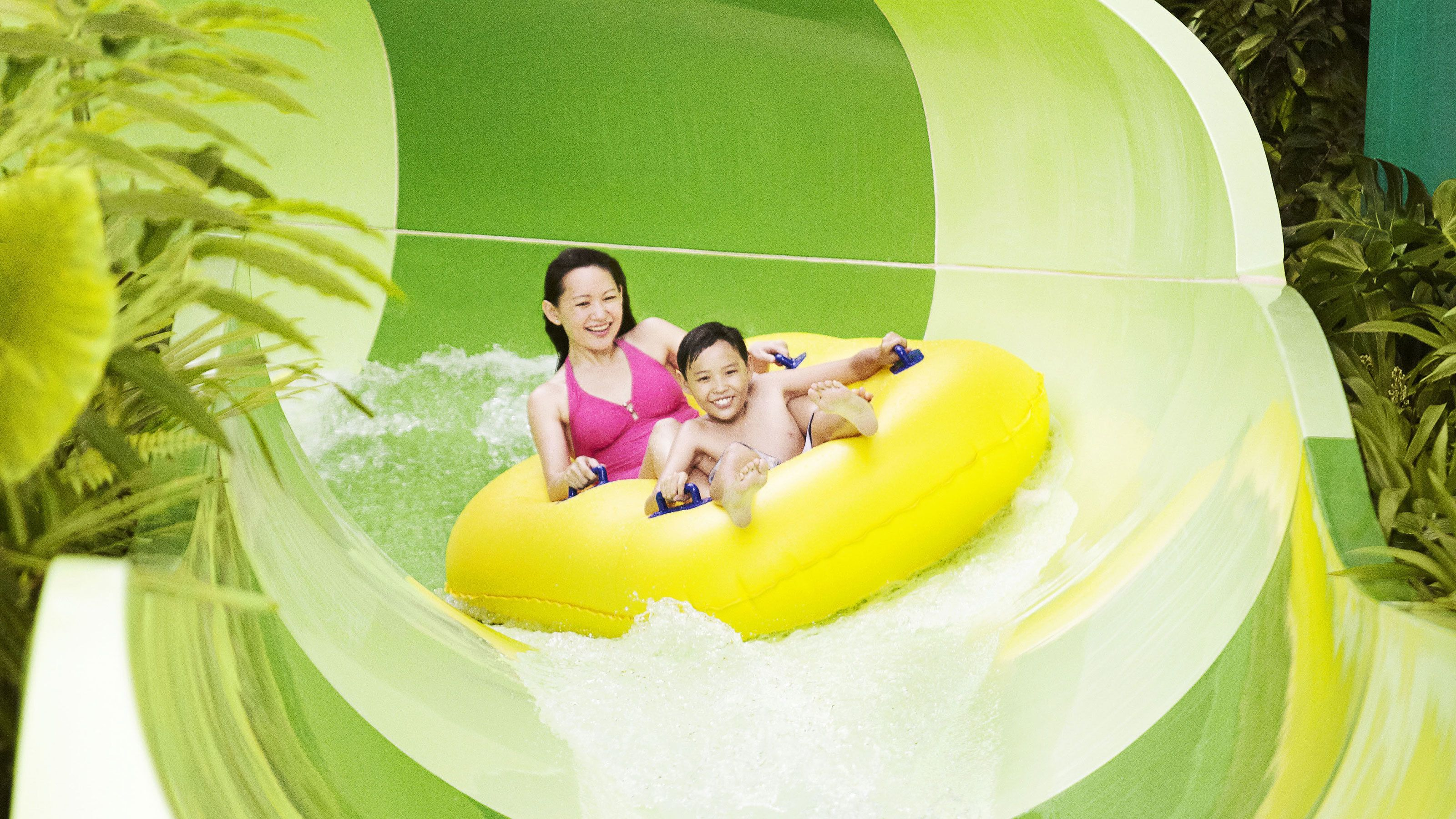 Mother and sone on waterslide at the adventure cove waterpark in Singapore