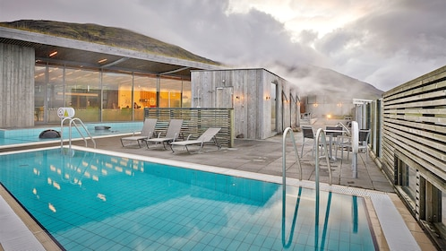 Pool and chaise lounges in the Laugarvatn Fontana geothermal spa in Reykjavik