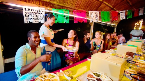 Waitress serves a table on a Mexican party boat