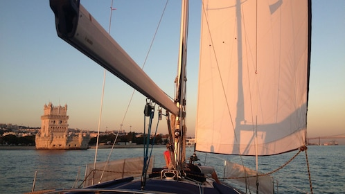 watching the sunset from the deck of a sailboat in Lisbon
