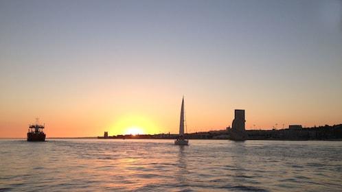 sun setting into the horizon in Lisbon