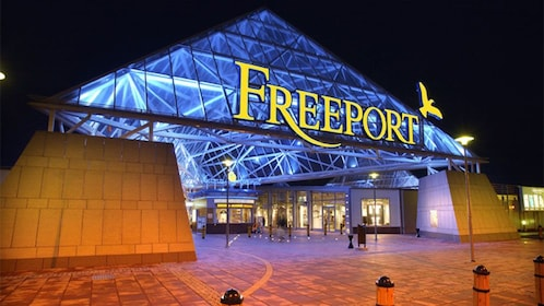 the Freeport shopping center at night in Lisbon