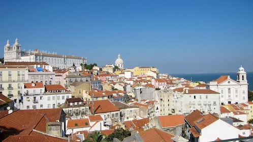 vibrant red roofs covering the city of Lisbon