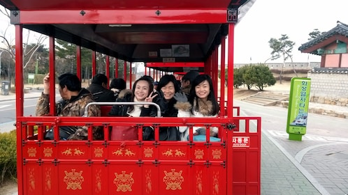 girls on trolley in seoul