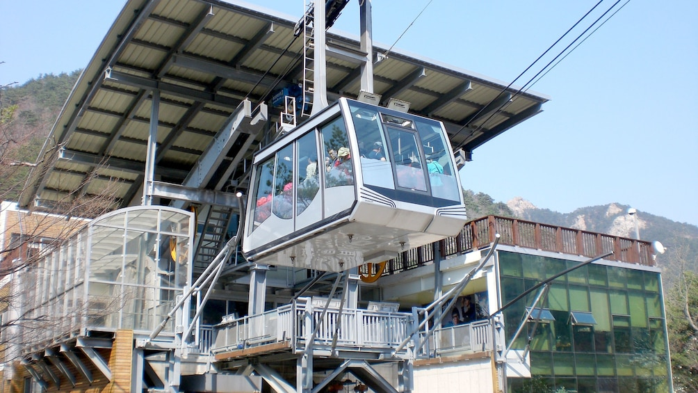 Show item 4 of 5. Mountain gondola in seoul