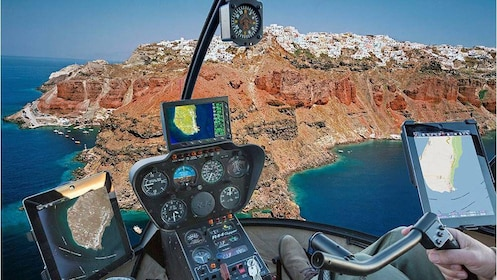 View inside a helicopter flying over Santorini