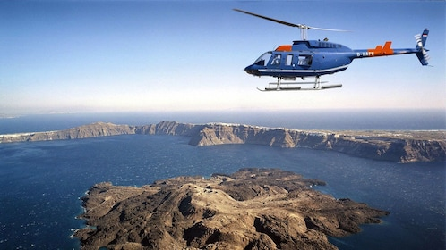 Serene view of a helicopter flying above Santorini