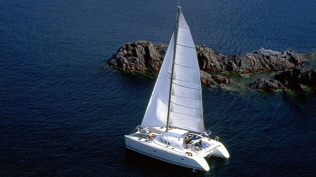 Show item 1 of 9. Beautiful view of a catamaran on the waters in Santorini