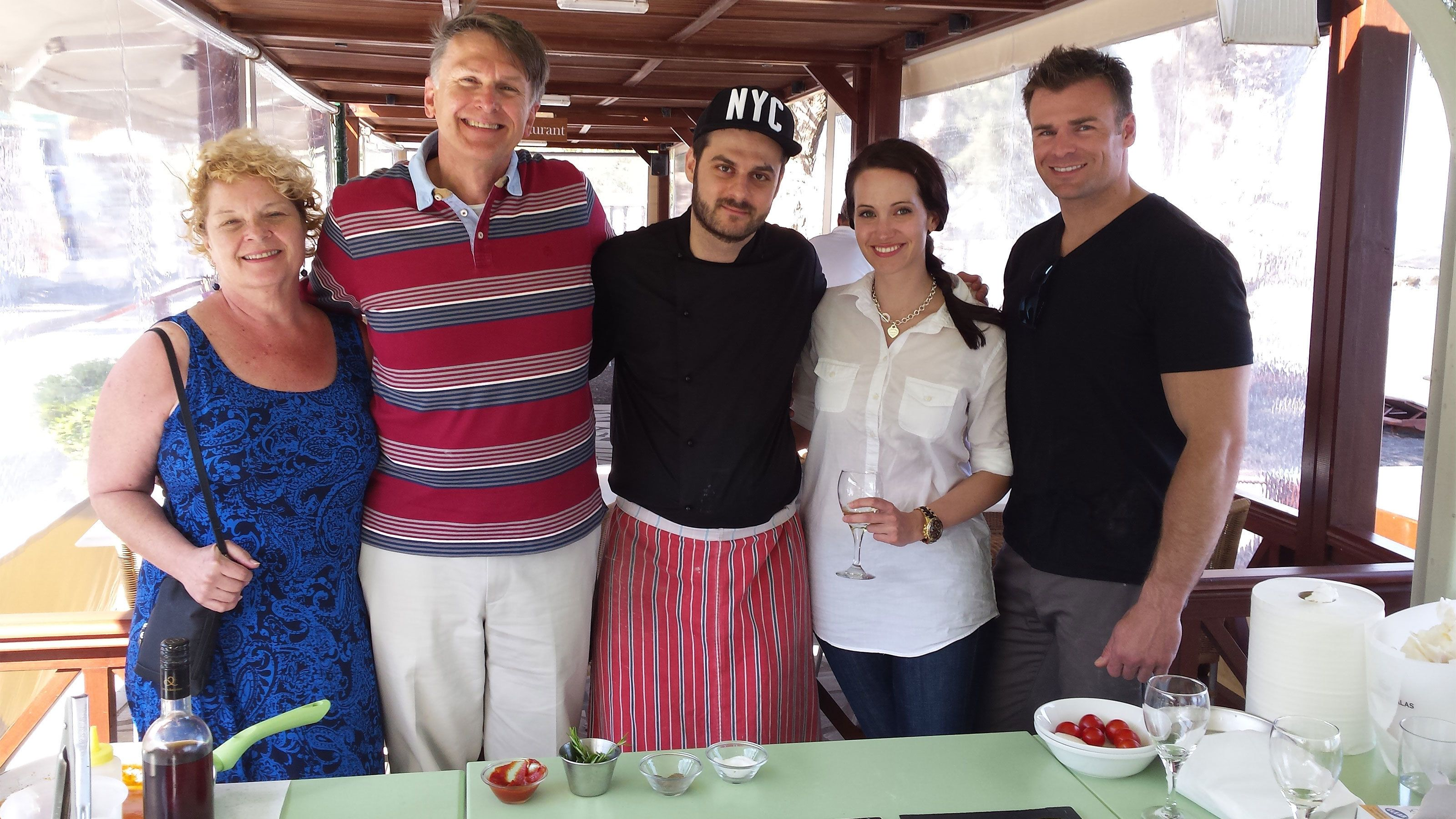 Group taking a photo at a cooking class in Santorini