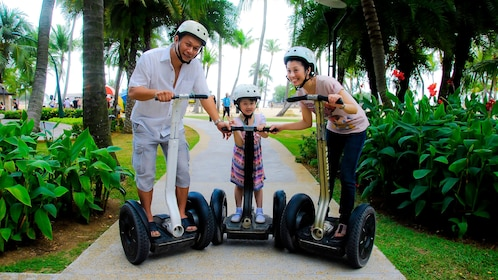 family with young girl on segways in singapore
