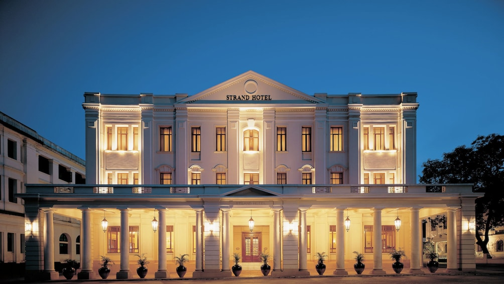 Show item 9 of 9. Strand Hotel at night in Yangon