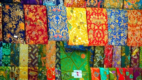 Colorful silks and other fabrics at a market in Yangon