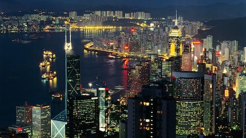 Boats at the harbour at night in Hong Kong