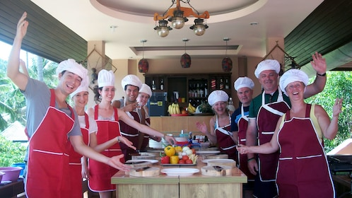 A group of people at  Chanita Thai Cooking School in Koh Samui