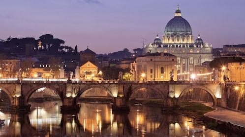 Illuminated city scene at night on Easy Rome tour in Italy