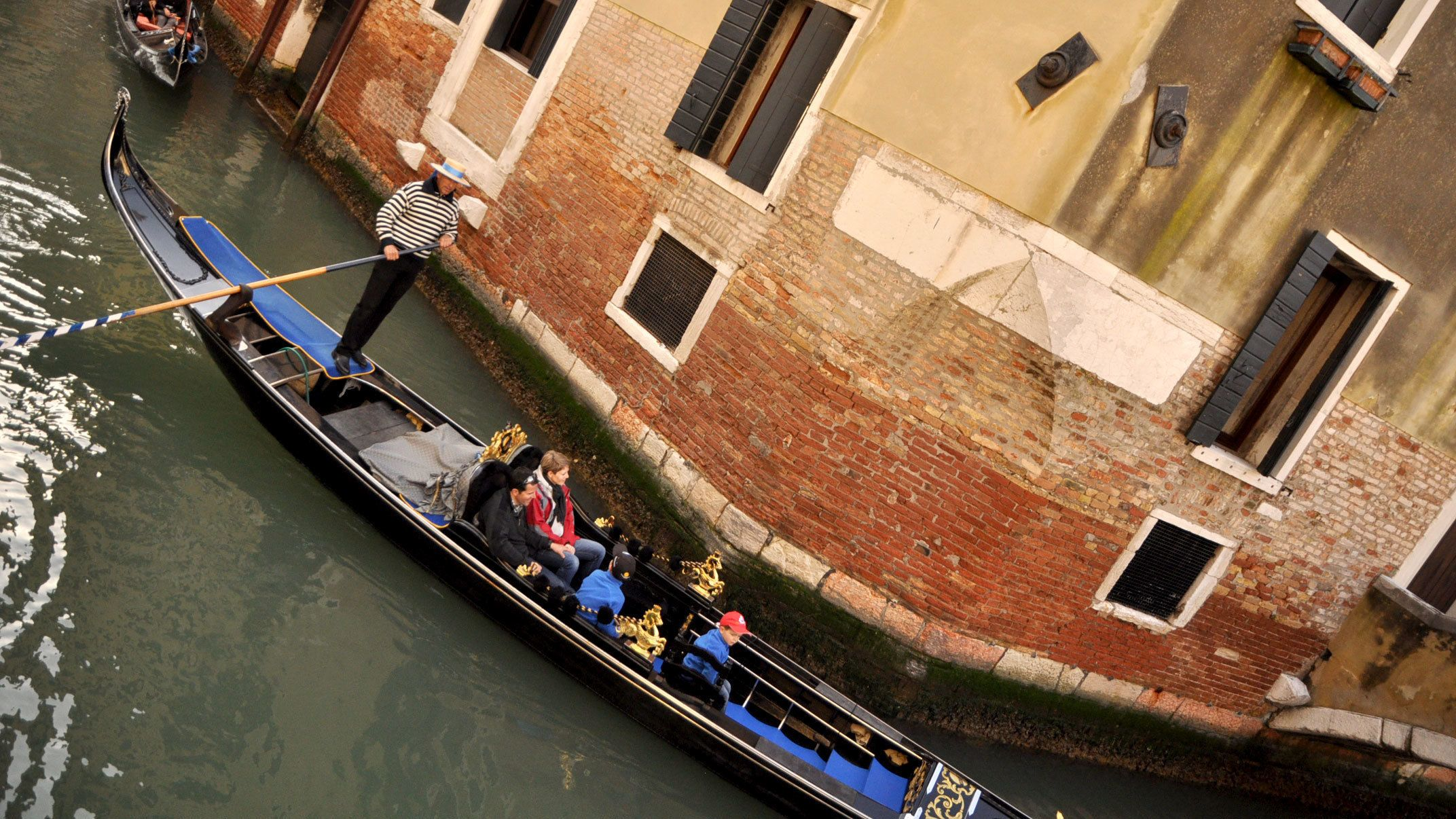 gondola turning a corner in a canal in Venice Italy