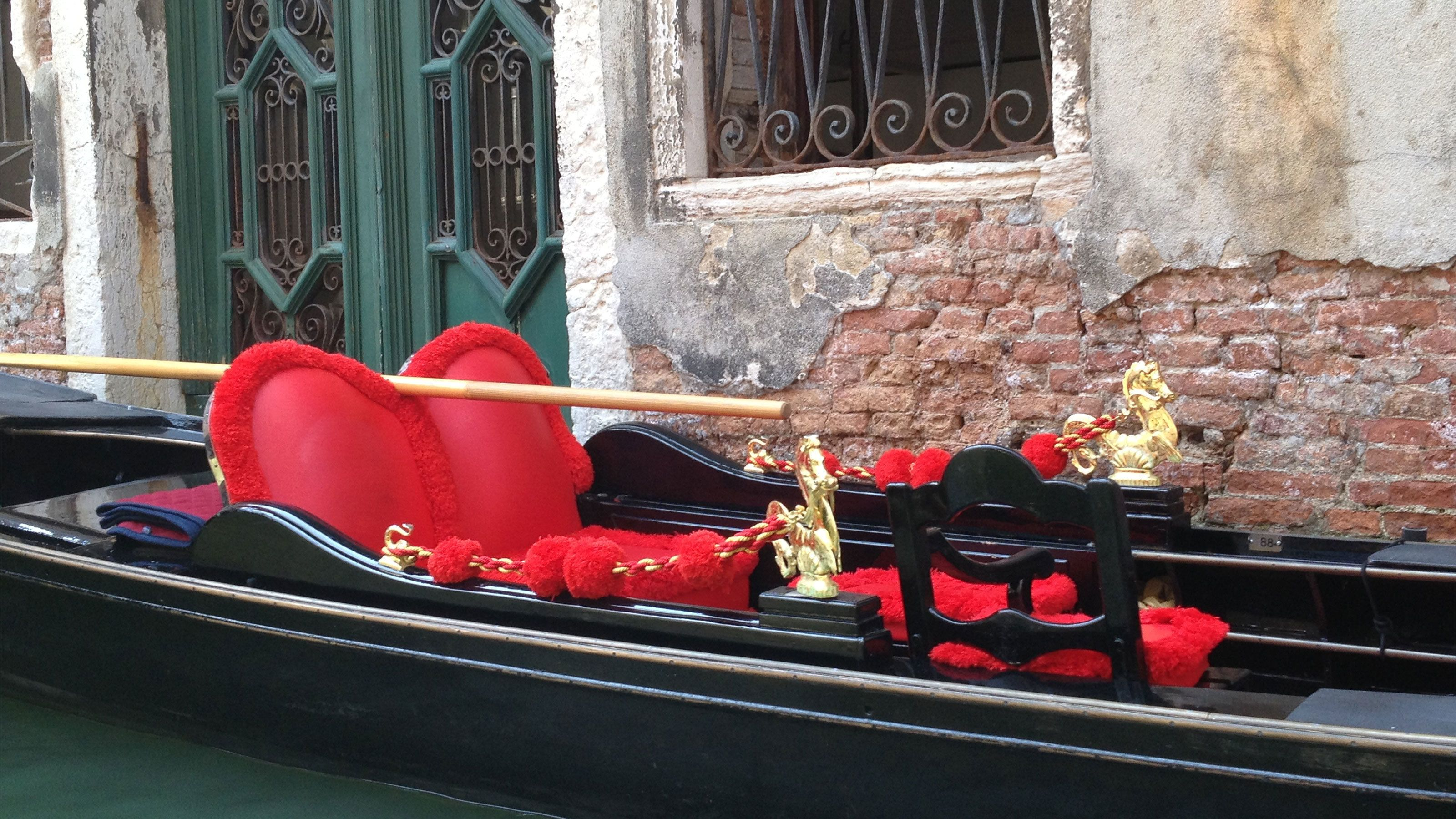 Gondola with heart pillow in Venice Italy