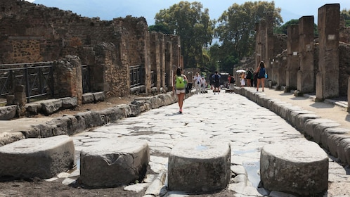 Group of people exploring the ruins of Pompeii.