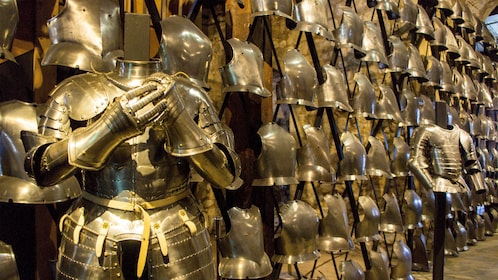 a wall lined with suits of armor in Tower of London