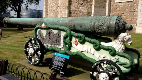 bronze canon on decorated cart in London