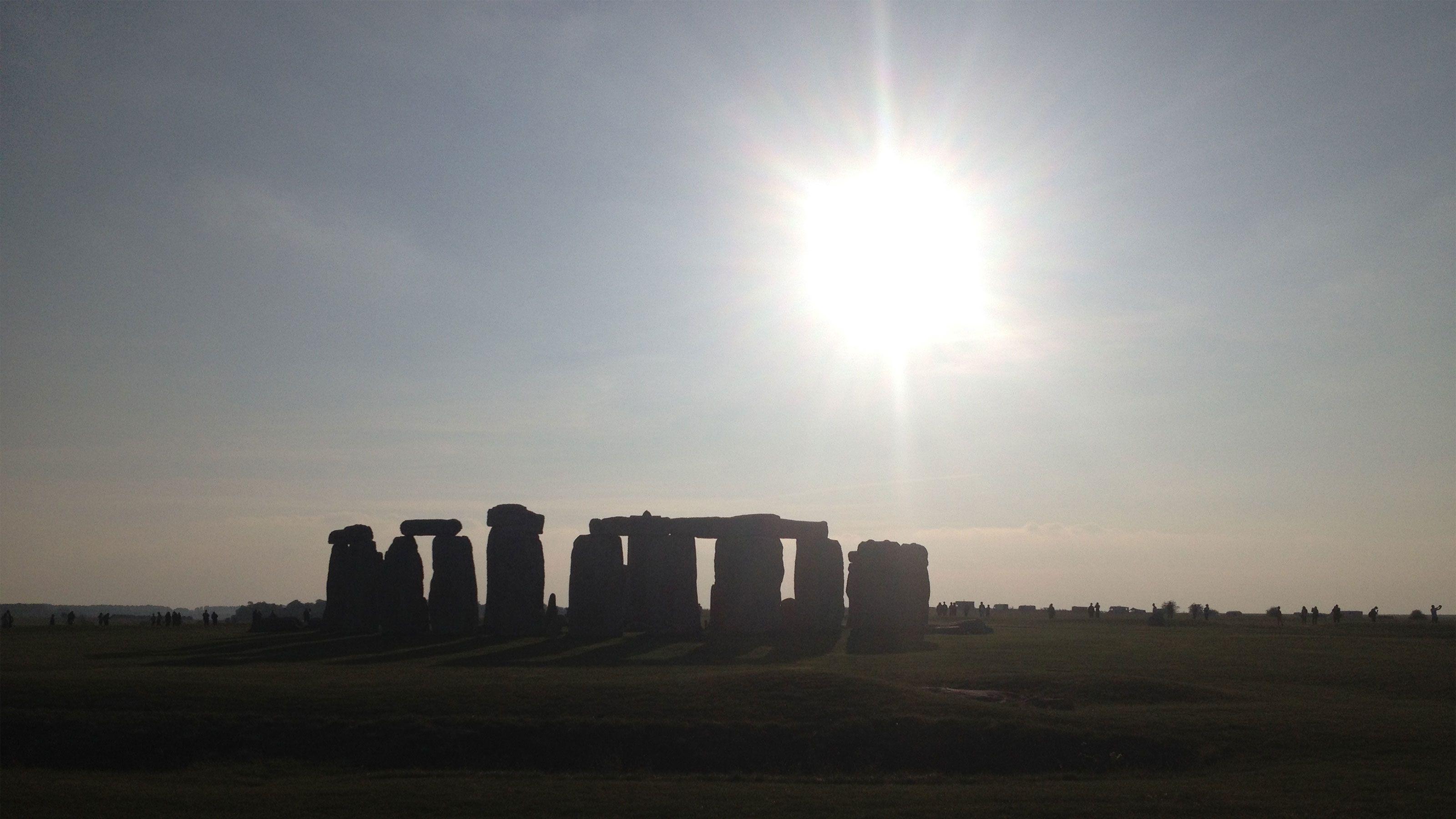 bright sun shining over Stonehenge in London