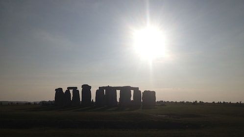 bright sun shining over Stonehenge in London