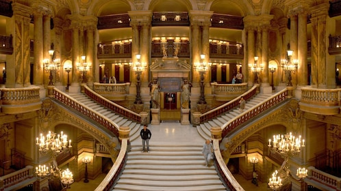 On the grand staircase inside the Opera Garnier in Paris