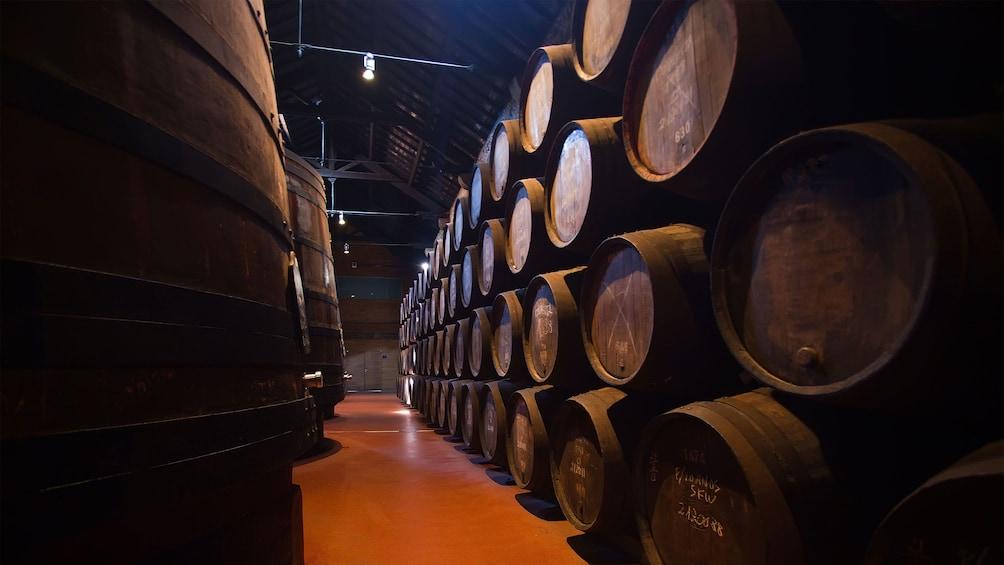Show item 2 of 6. Barrels of wine storage at the Calém Wine Cellars in Porto