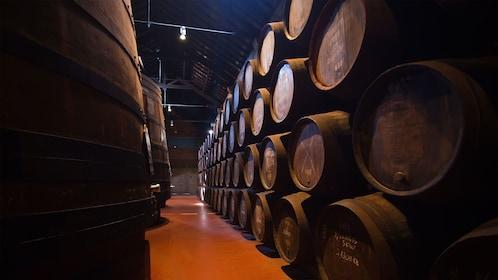 Barrels of wine storage at the Calém Wine Cellars in Porto