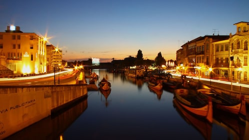 Canal and city lit up at night in Aveiro