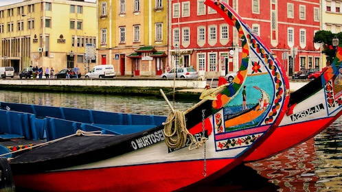 Colorful boats on a canal in Aveiro