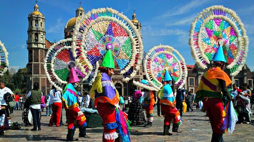 colorful performers outside the Guadalupe shrine