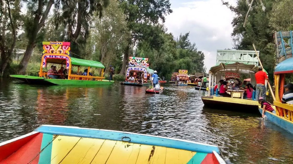 Show item 3 of 10. Colorful boats on the Xochimilco Canals