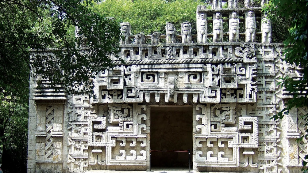 Show item 3 of 9. Hochob temple entrance reconstruction at the NAtional Museum of Antropology in Mexico city