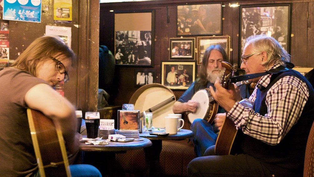men playing banjo and guitar in pub in  Dublin