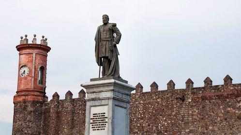 Bronze statue on a pedestal in Cuernavaca