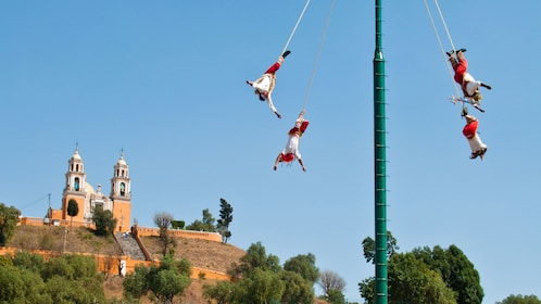 Acrobats performing aerial feats in Peubla