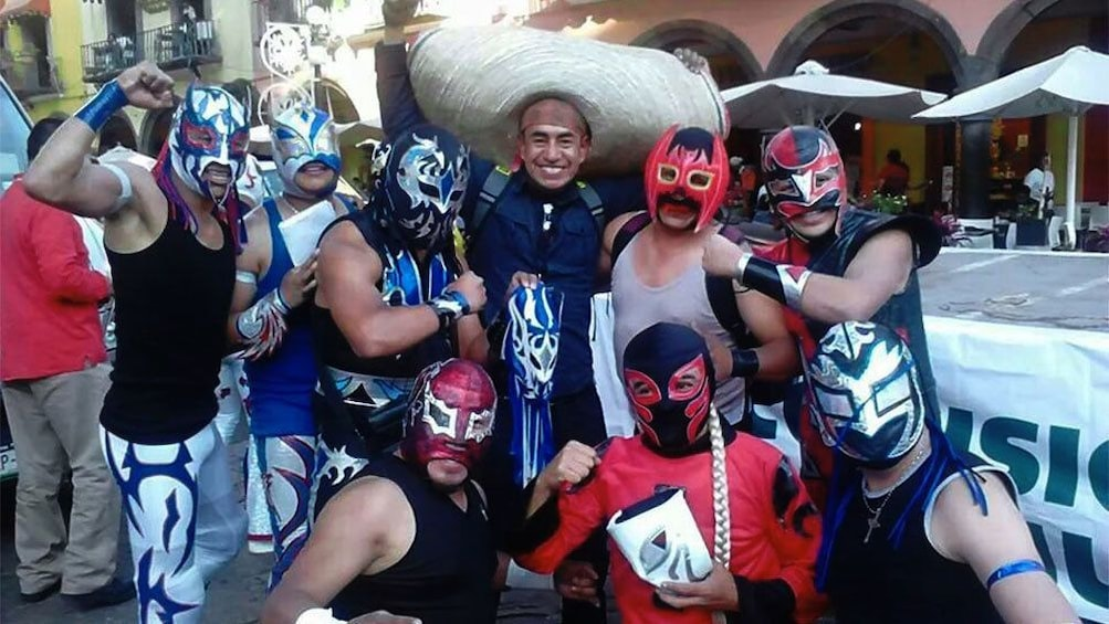 Tour group wearing lucha libre masks in Mexico