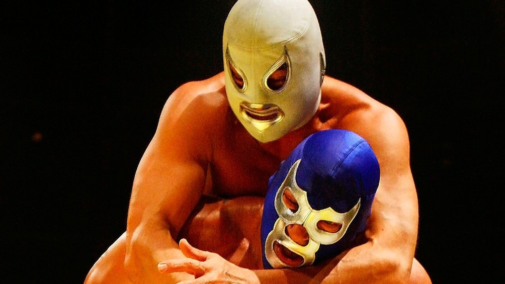 Two masked Lucha Libre fighters wrestling