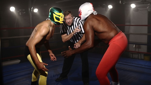 Two lucha libre fighters about to being a fight