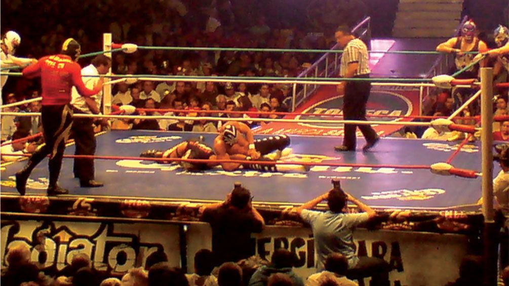 Two lucha libre fighters in the ring