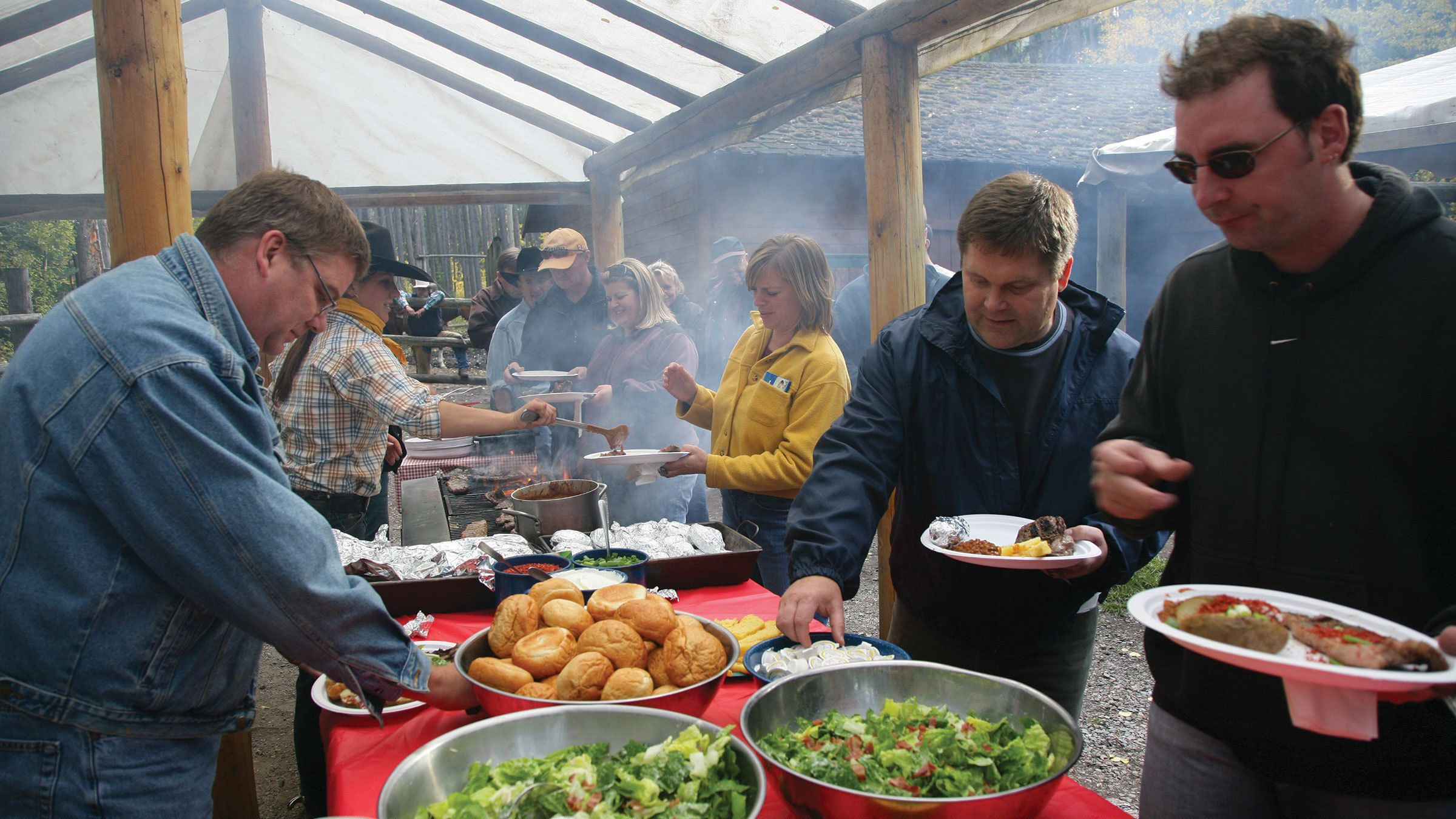 Guests preparing to feast on a delicious meal featuring grilled steak