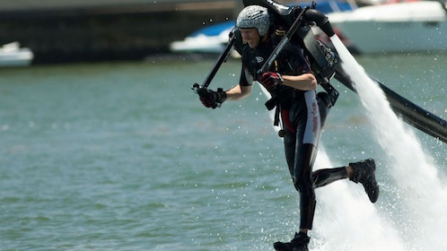 Person flying right above water with hydro jetpack in Sydney