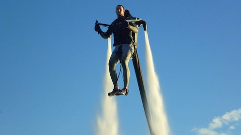 Person flying high with hydro jetpack in Sydney